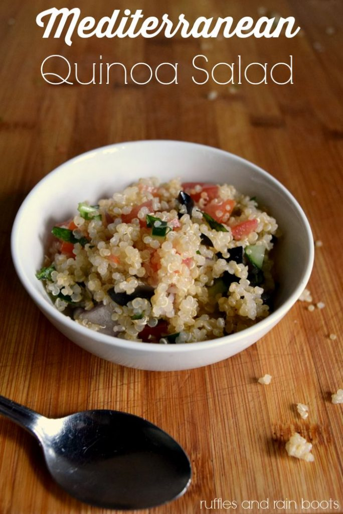 Whip up this Easy Mediterranean Quinoa Salad Recipe in just minutes - it's like a Greek salad with even more delicious goodness! #rufflesandrainboots #quinoa #mediterranean