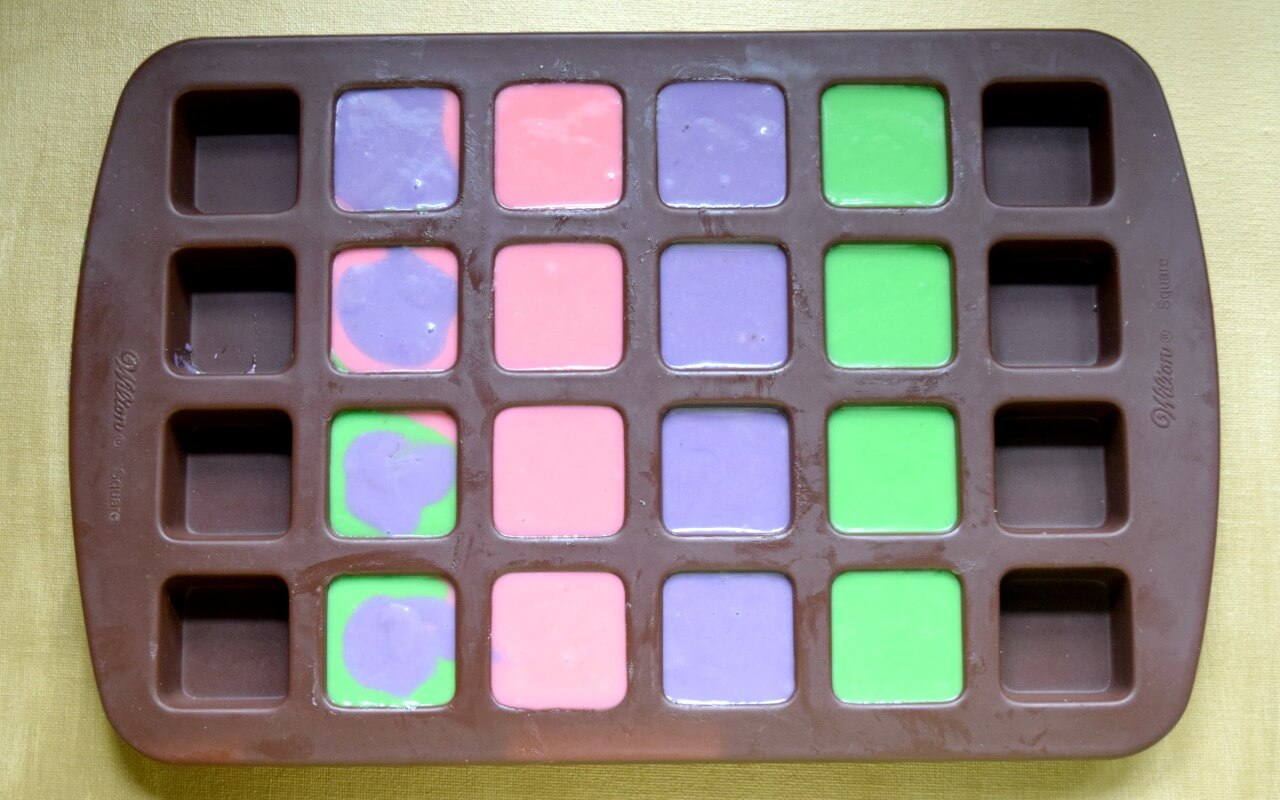 colorful cake batter in silicone mold