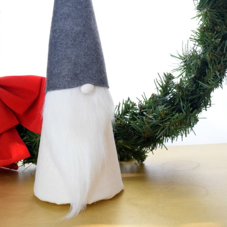 Make this easy DIY Christmas gnome for holiday decor. It has a cute button nose and fits in with any decorating style! #DIYcrafts #DIYholiday #handmadeholiday #Christmascrafts #minimalism