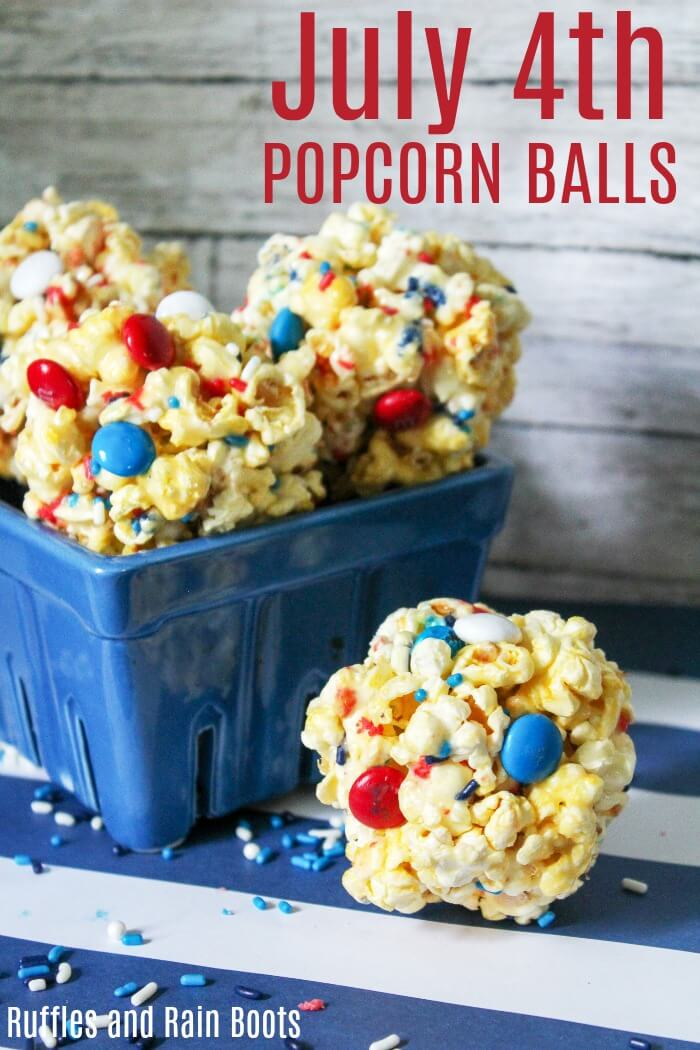 Make this fun favorite - July 4th popcorn balls. They are quick to come together and the kids will love making them. #popcorn #july4th #independenceday #July4thfood #popcornball #popcornrecipes #mandms #rufflesandrainboots
