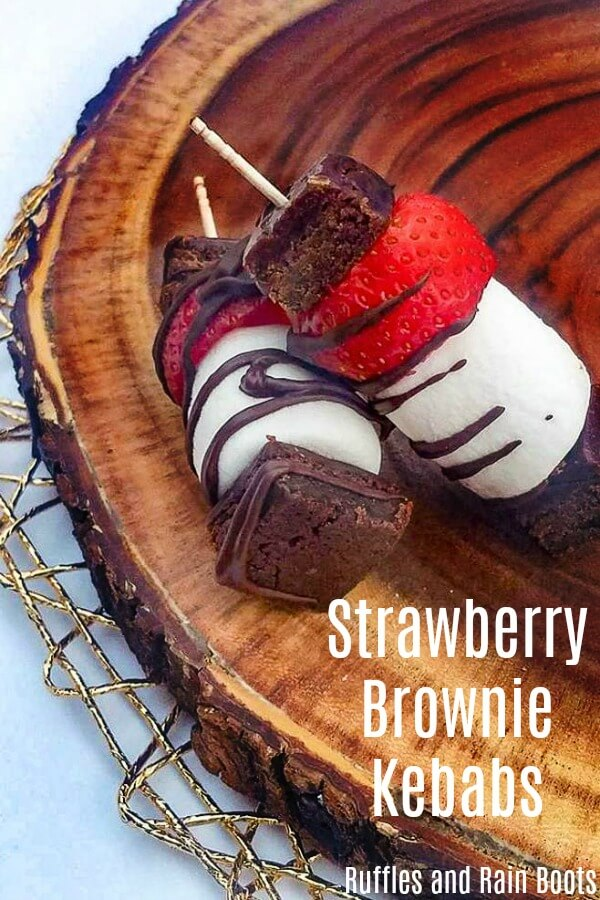 Easy, delicious, and fun to make and eat, these strawberry brownie skewers will be a crowd-pleaser. Make ahead for any get-together! #strawberry #strawberryrecipes #strawberrydesserts #easydesserts #dessertideas #strawberryseason #kebabs #dessertkebabs #treatkebabs #foodonastick #browniebites #strawberrybrownie #rufflesandrainboots