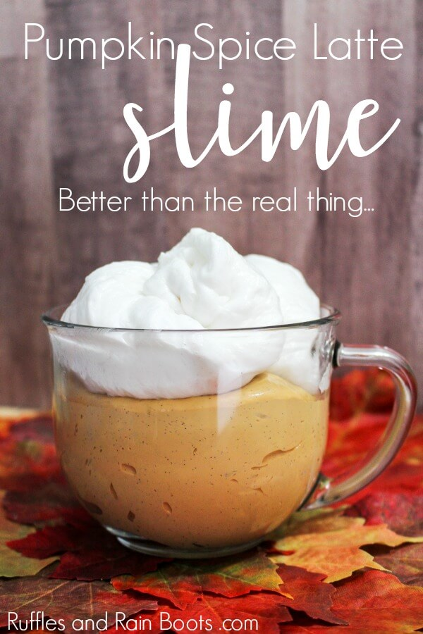 orange slime with white foamy slime on top in a clear glass cup with text that reads pumpkin spice slime