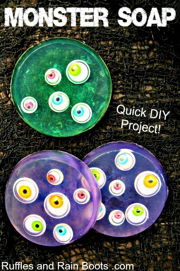 close up of green and purple soap with colored googly eyes on black background with text monster soap
