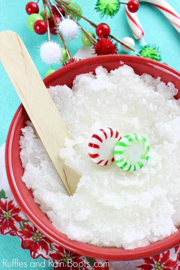 white Christmas body scrub with candy canes on blue background