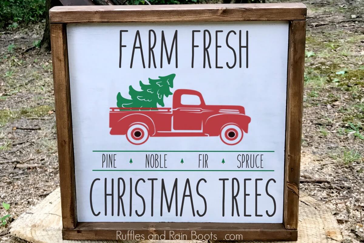 wood sign with image of red Christmas truck SVG with text which reads Farm Fresh Christmas Trees