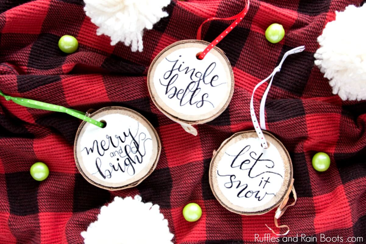 3 DIY hand lettered ornament samples on a red buffalo plaid Christmas background