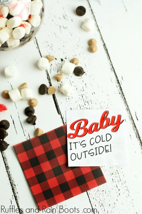 free printable gift tag for hot chocolate ornament with text which reads Baby, It's cold outside