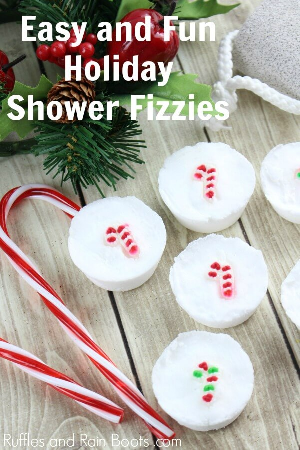 candy cane Christmas shower bombs on wood background with text which reads Easy and fun holiday shower fizzies