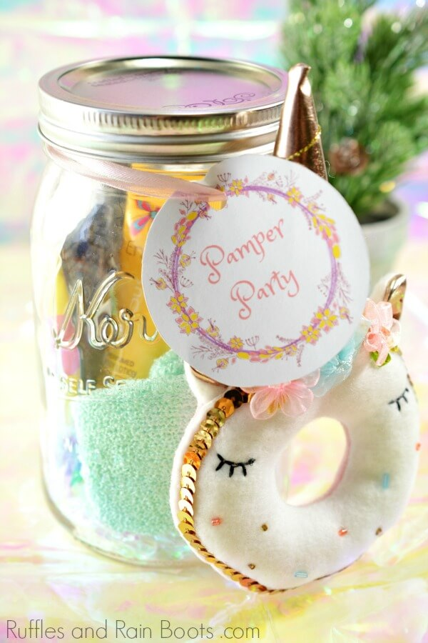 mason jar filled gift for teen girls with beauty products and unicorn ornament