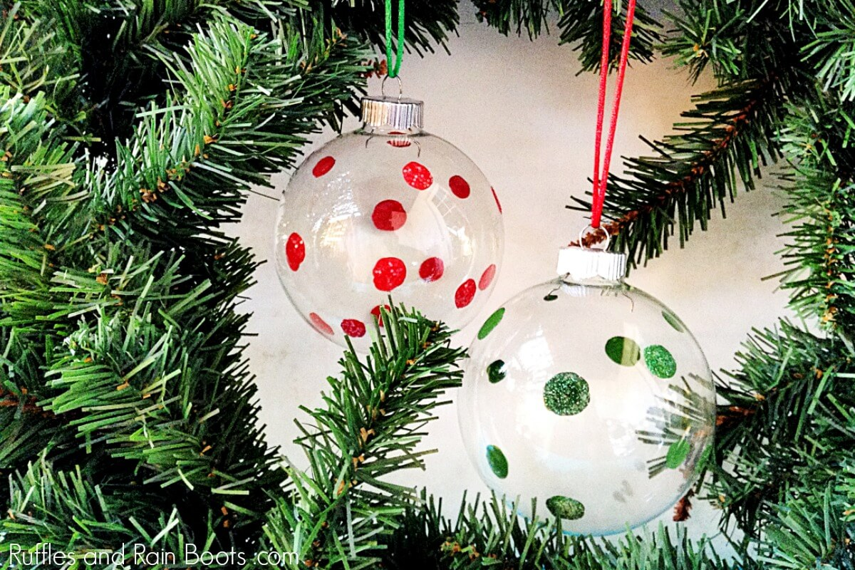 DIY Polka Dot ornaments with glitter on holiday background