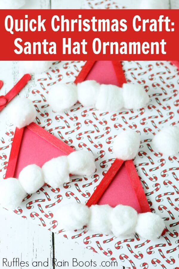 adorable Christmas Santa Hat Craft Stick ornament on holiday background with text which reads quick Christmas craft Santa hat ornament