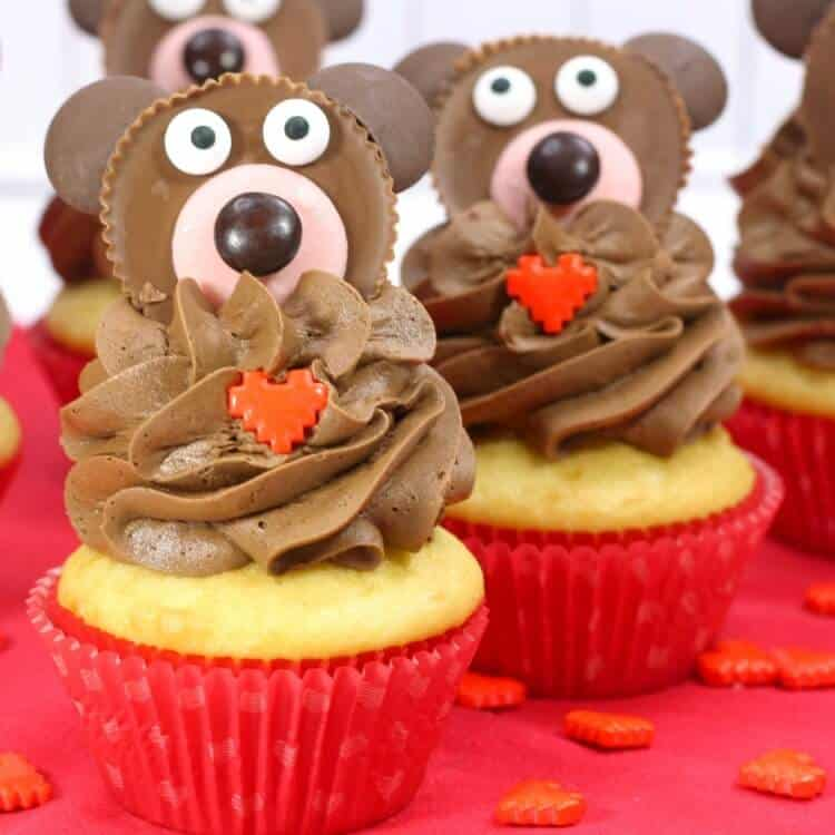 teddy bear cupcakes in red liners on red background with hearts