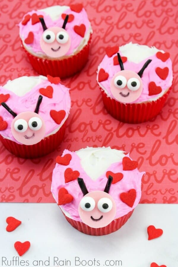 love bug cupcake for Valentines Day on red and white background with text which reads ruffles and rain boots