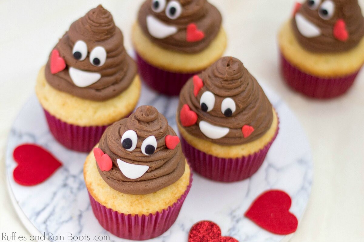 close up of poop emoji cupcakes with hearts for a Valentine's Day cupcake idea