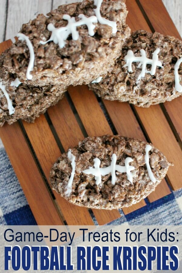 chocolate Rice Krispies shaped footballs on wood background with text which reads game day treats for kids football Rice Krispies