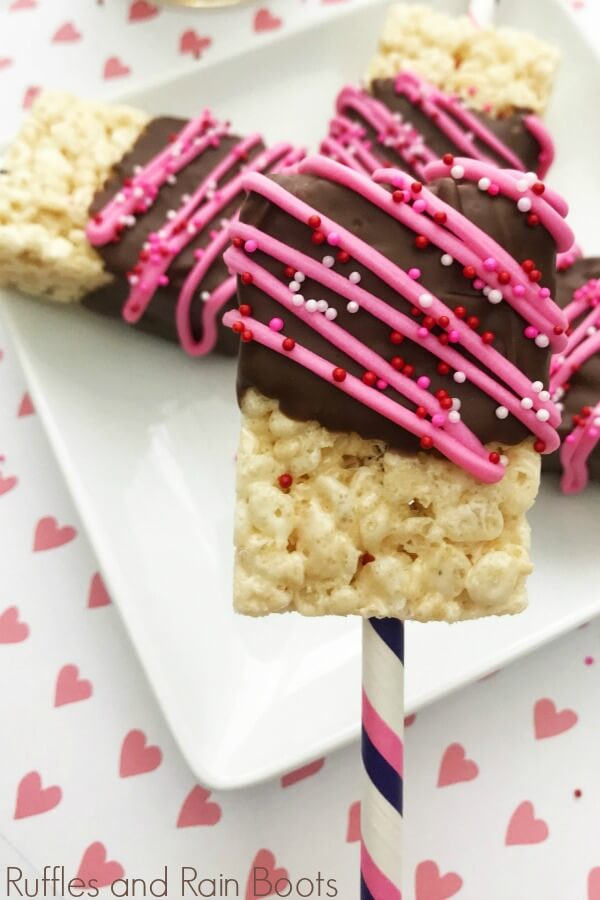 Dipped Valentines Day Rice Cereal Treats on heart background