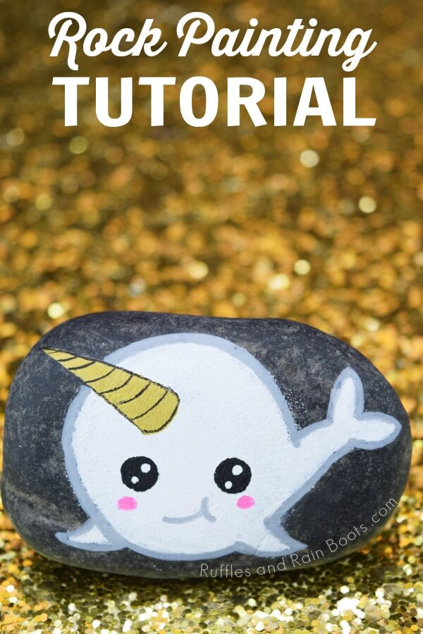 narwhal rock painting on gold glitter background with text which reads rock painting tutorial