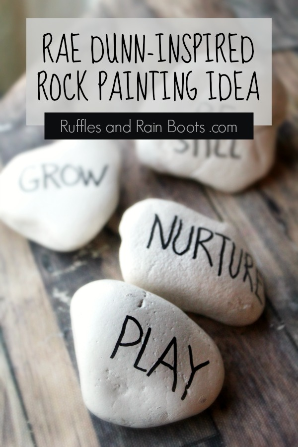 painted rocks on wood background with text which reads rae dunn inspired rock painting idea