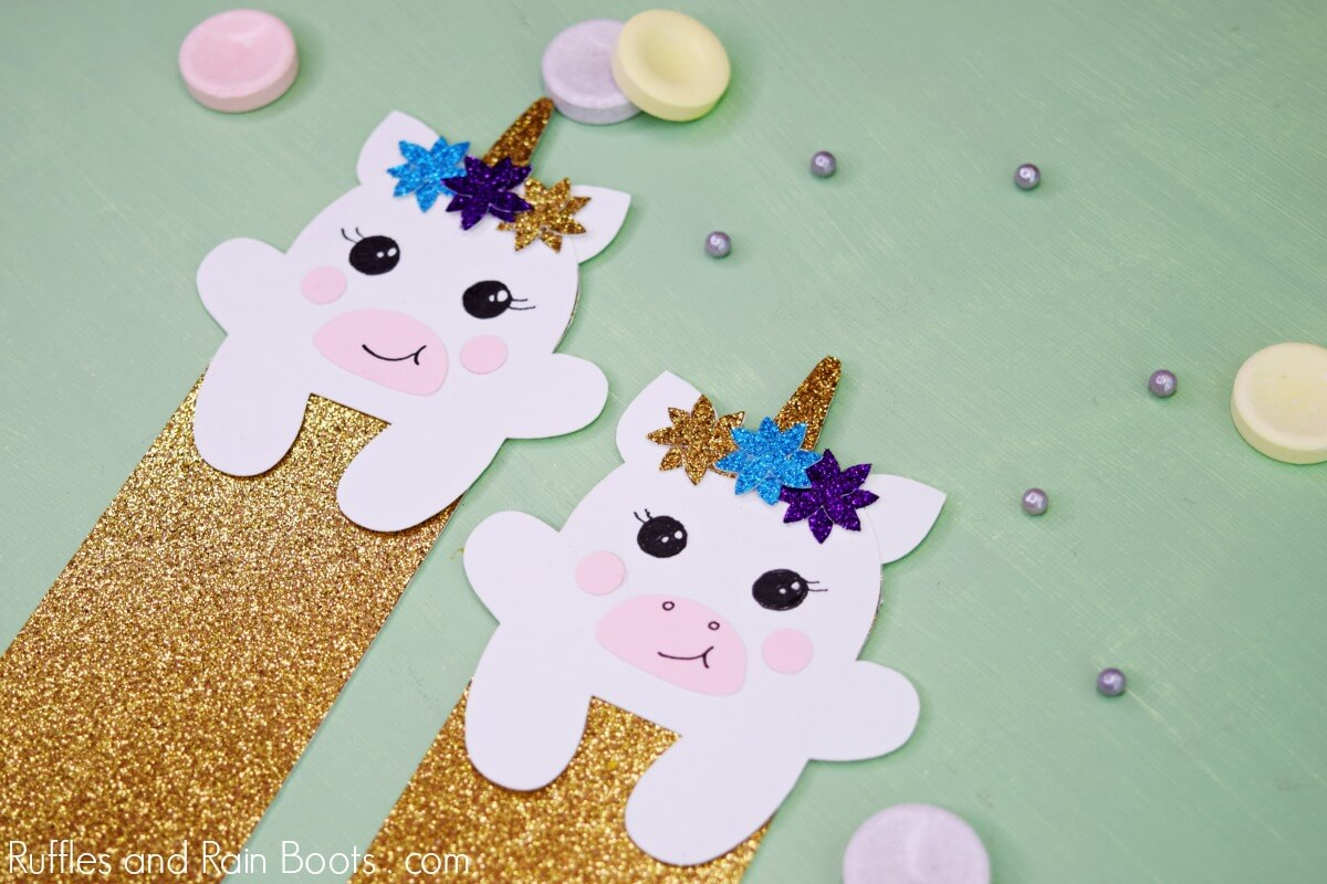glitter unicorn hug bookmark on green background