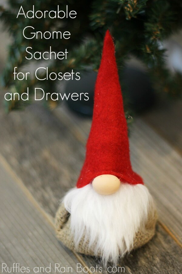 close up of red hat gnome on wood background with text which reads gnome lavender sachet