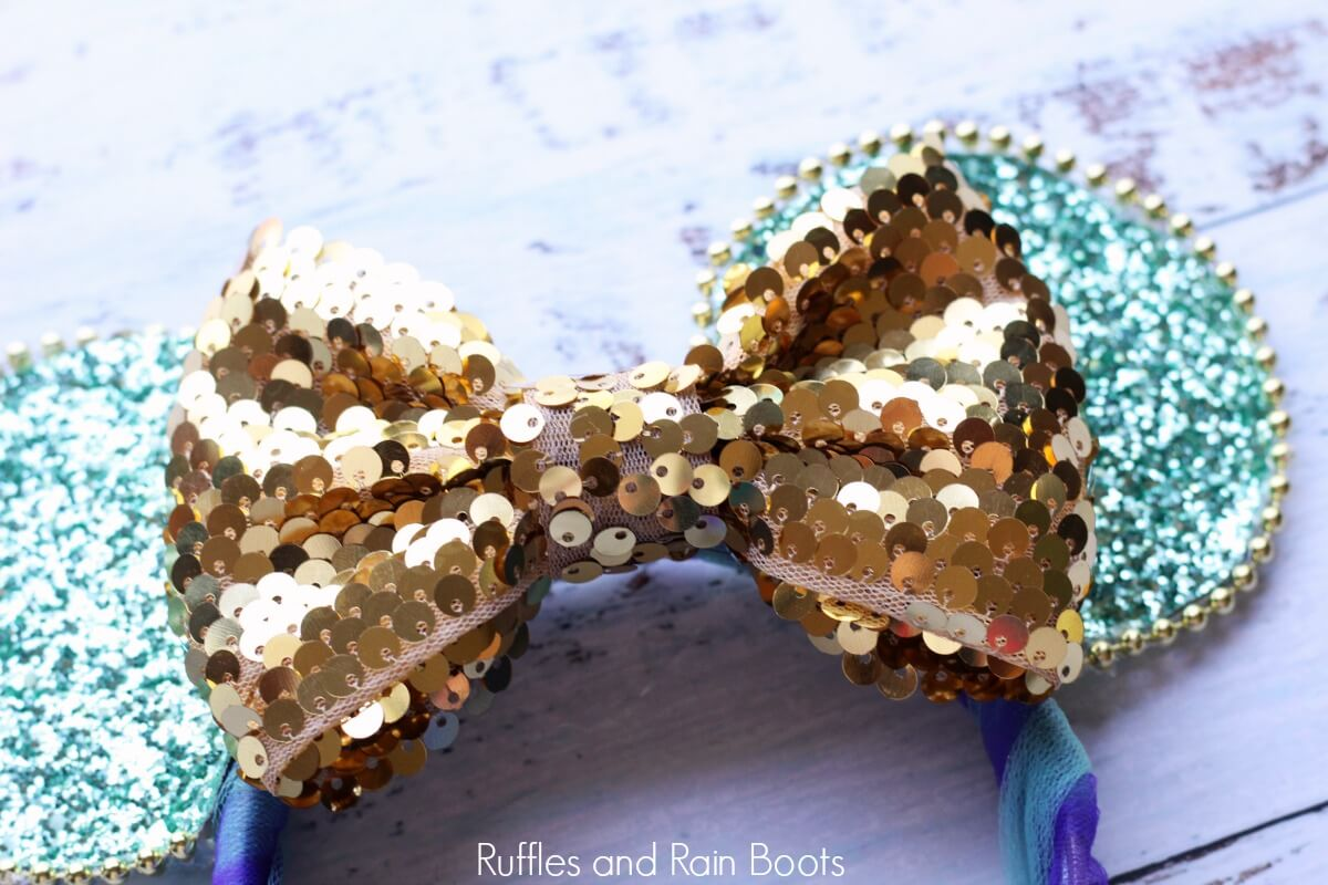 Princess Jasmine Mickey Mouse ears on wooden background