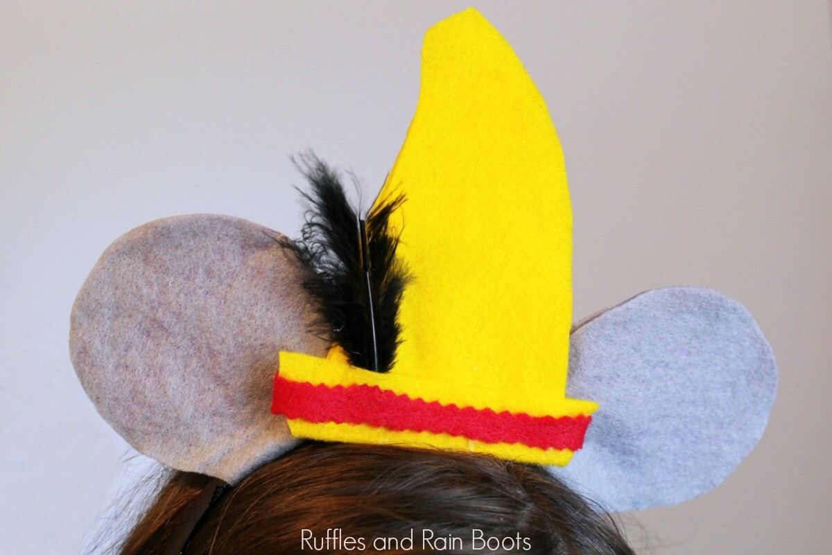 close up of Dumbo Mickey ears on little girl