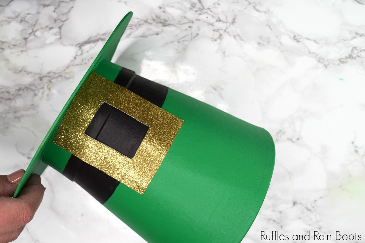 attach the buckle to the leprechaun hat