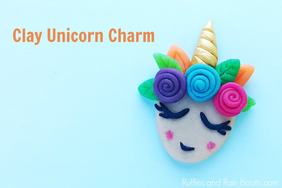 Clay unicorn charm on blue background