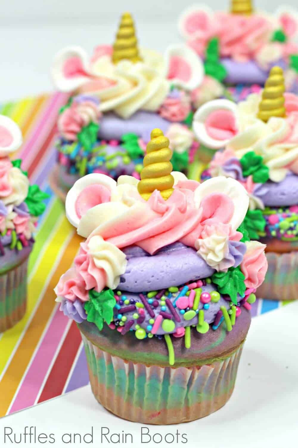 close up of colorful unicorn cupcakes recipe on rainbow background