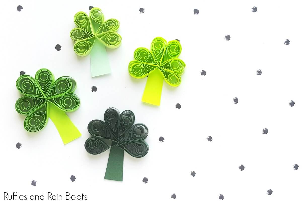 four quilled shamrocks on white background