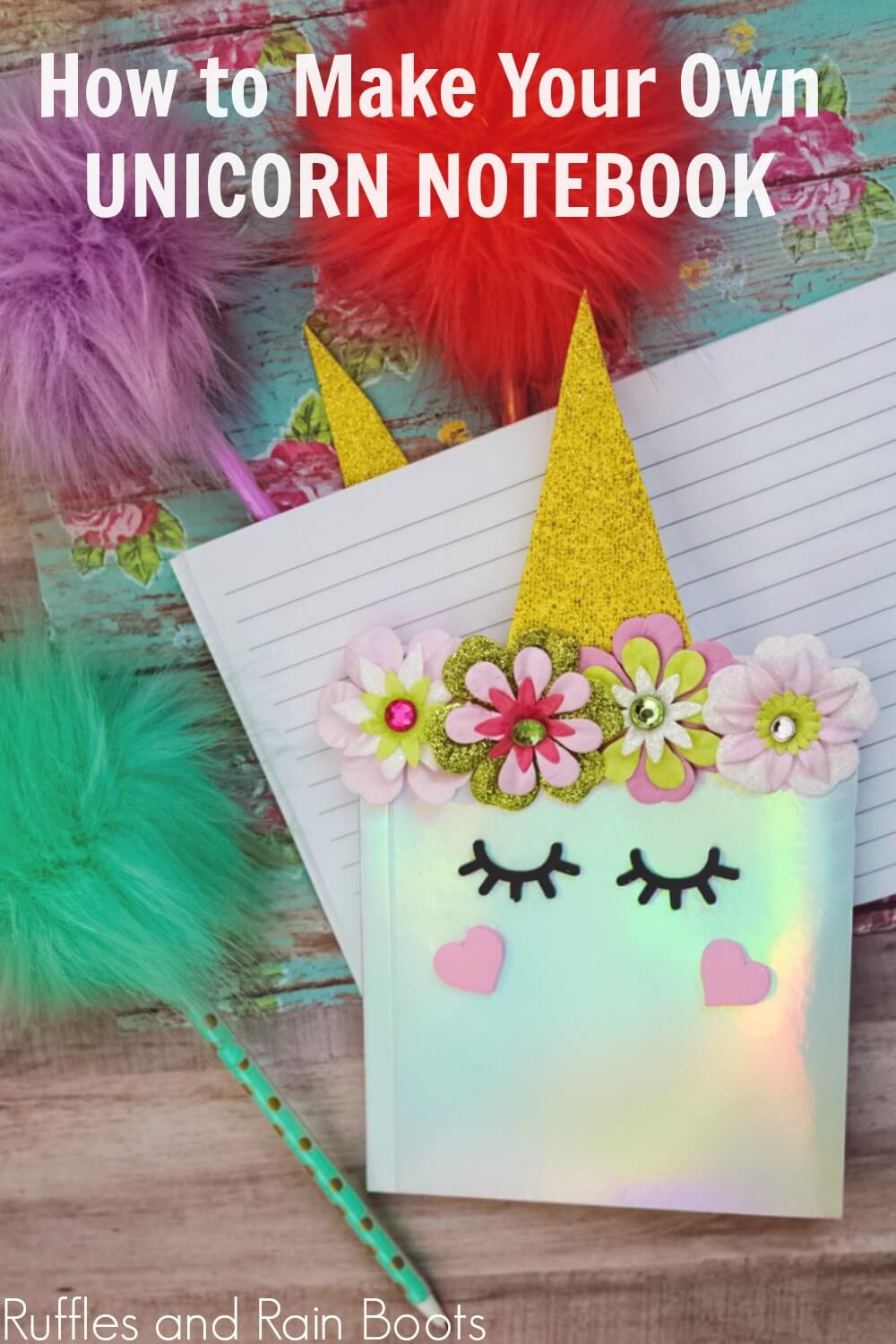 shimmery white unicorn notebook with colored pens in the background and text How to make your own Unicorn notebook