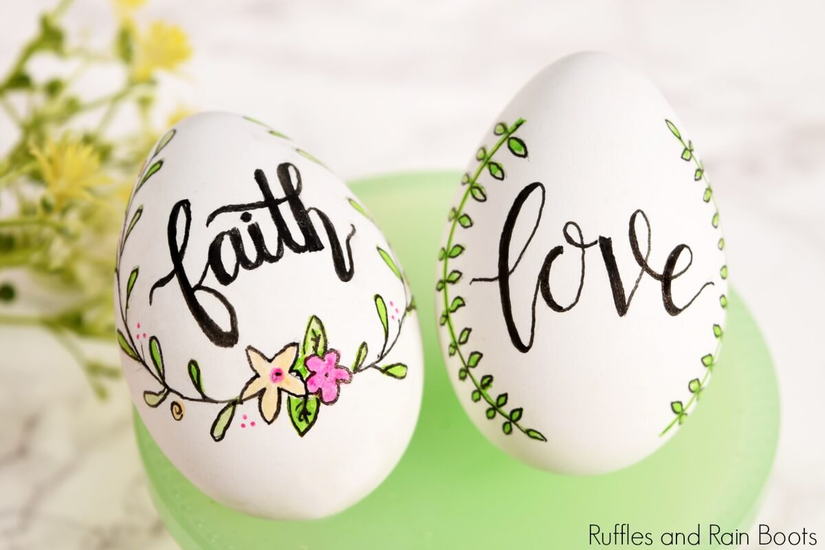 two hand lettered Easter eggs on milk glass stand