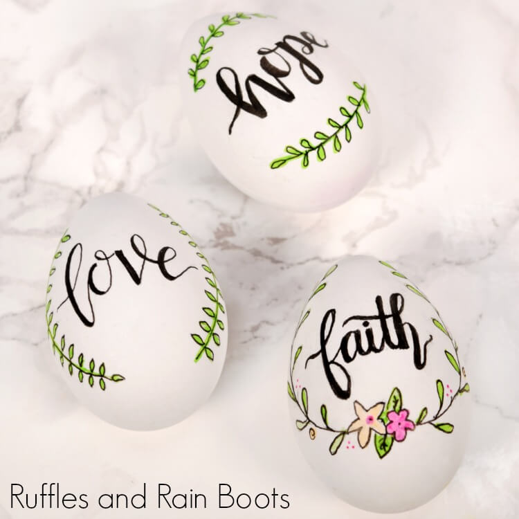 square close up of hand lettered Easter eggs for decor
