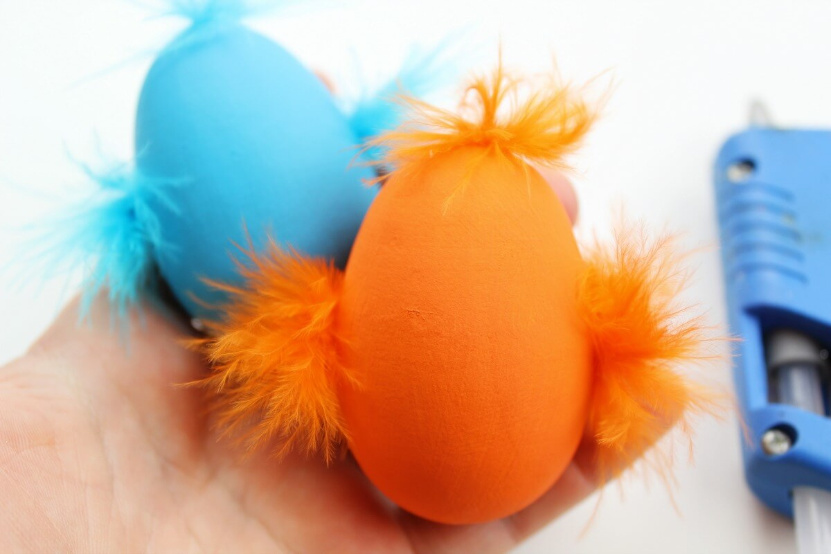 painted eggs with feathers glue on