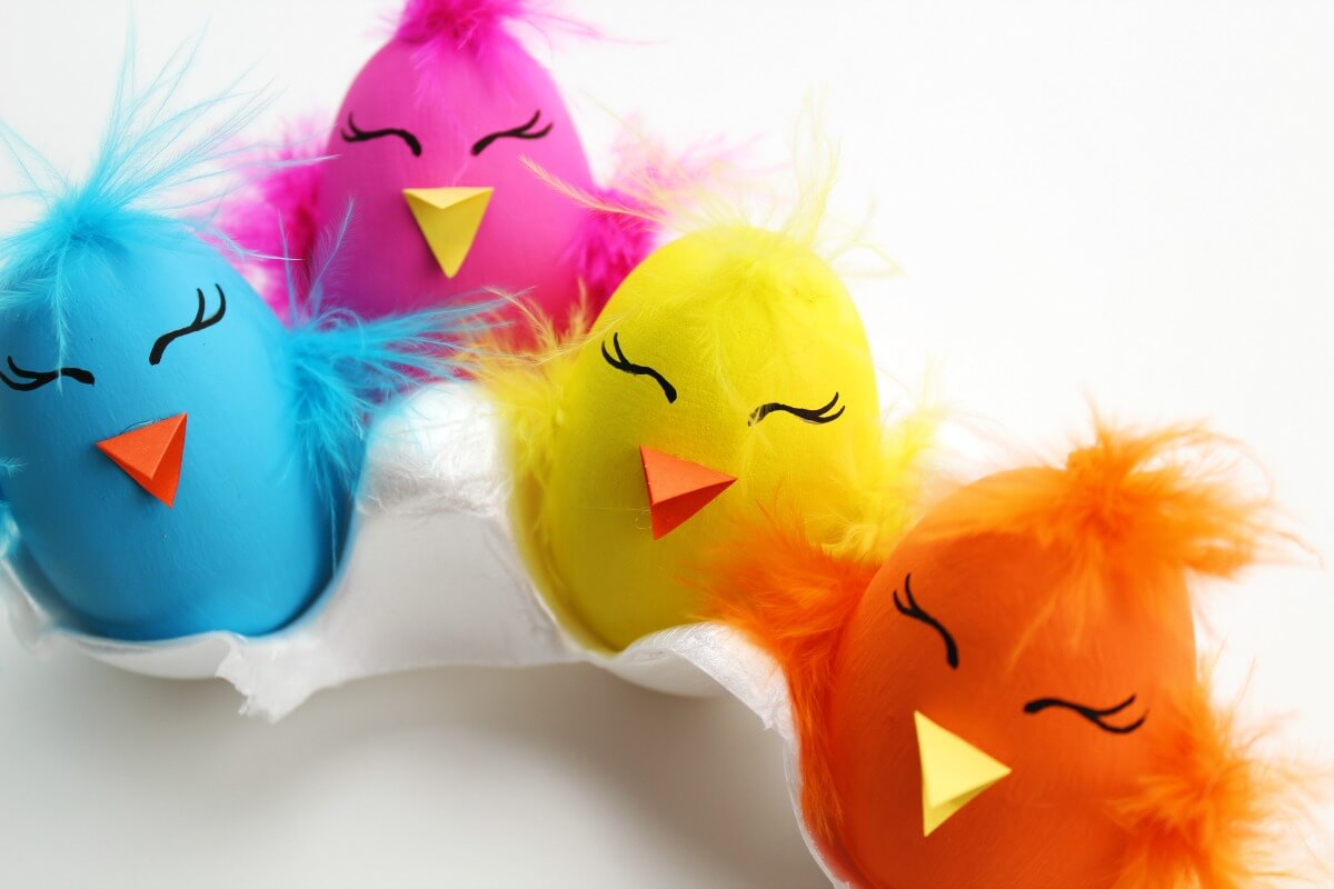 colorful chick Easter eggs on white background