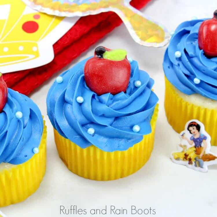 square image of Snow White cupcakes for a princess party on a white background