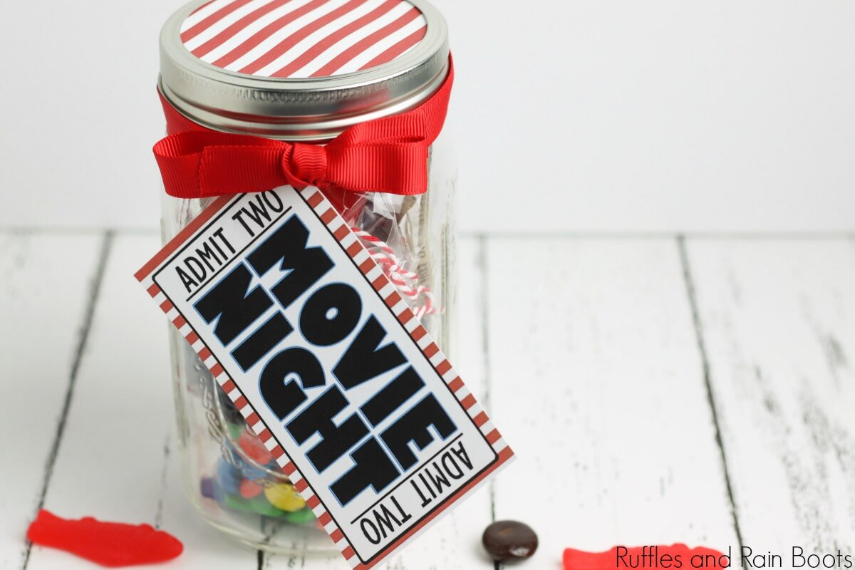 finished date night idea gift movie night in a jar on a white background