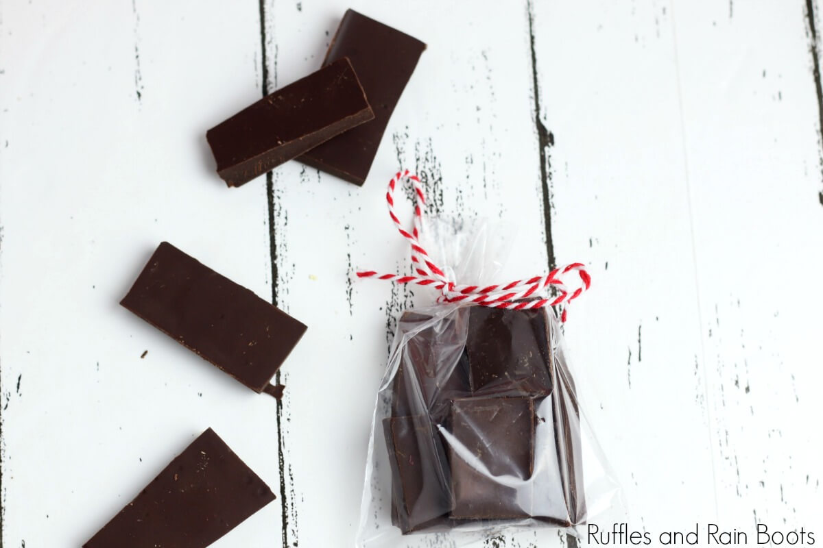chocolate candy in a bag on a white background used to illustrate a step of how to make a picnic date night in a jar