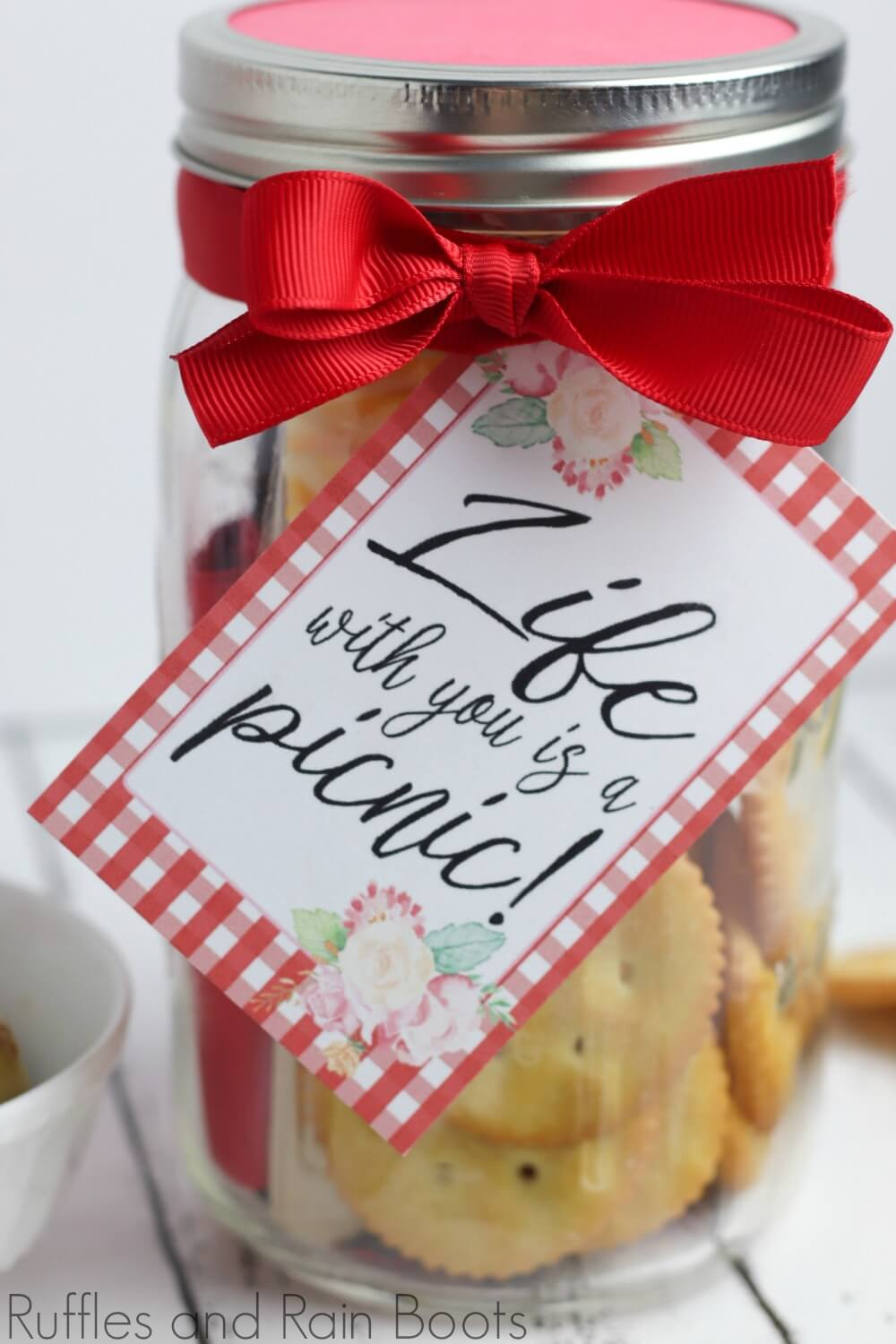 picnic date night in a jar on a white background with free printable tag which reads life with you is a picnic