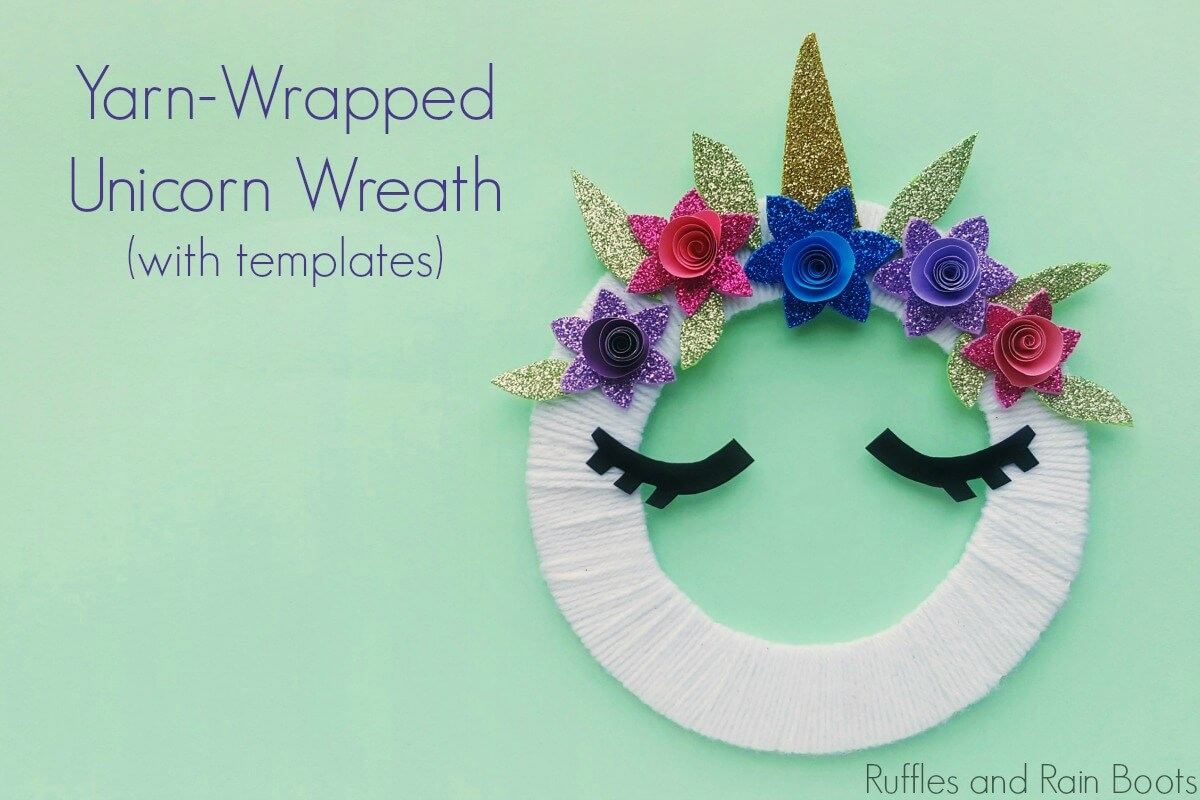 yarn wrapped unicorn wreath craft for kids on a teal background with text which reads yarn wrapped unicorn wreath