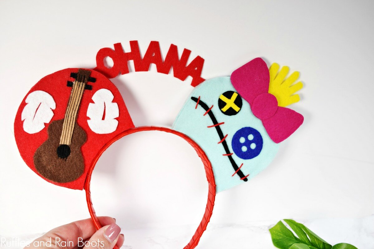 hand holding DIY Mickey Ears featuring Lilo and Scrump from Disney's Lilo and Stitch movie