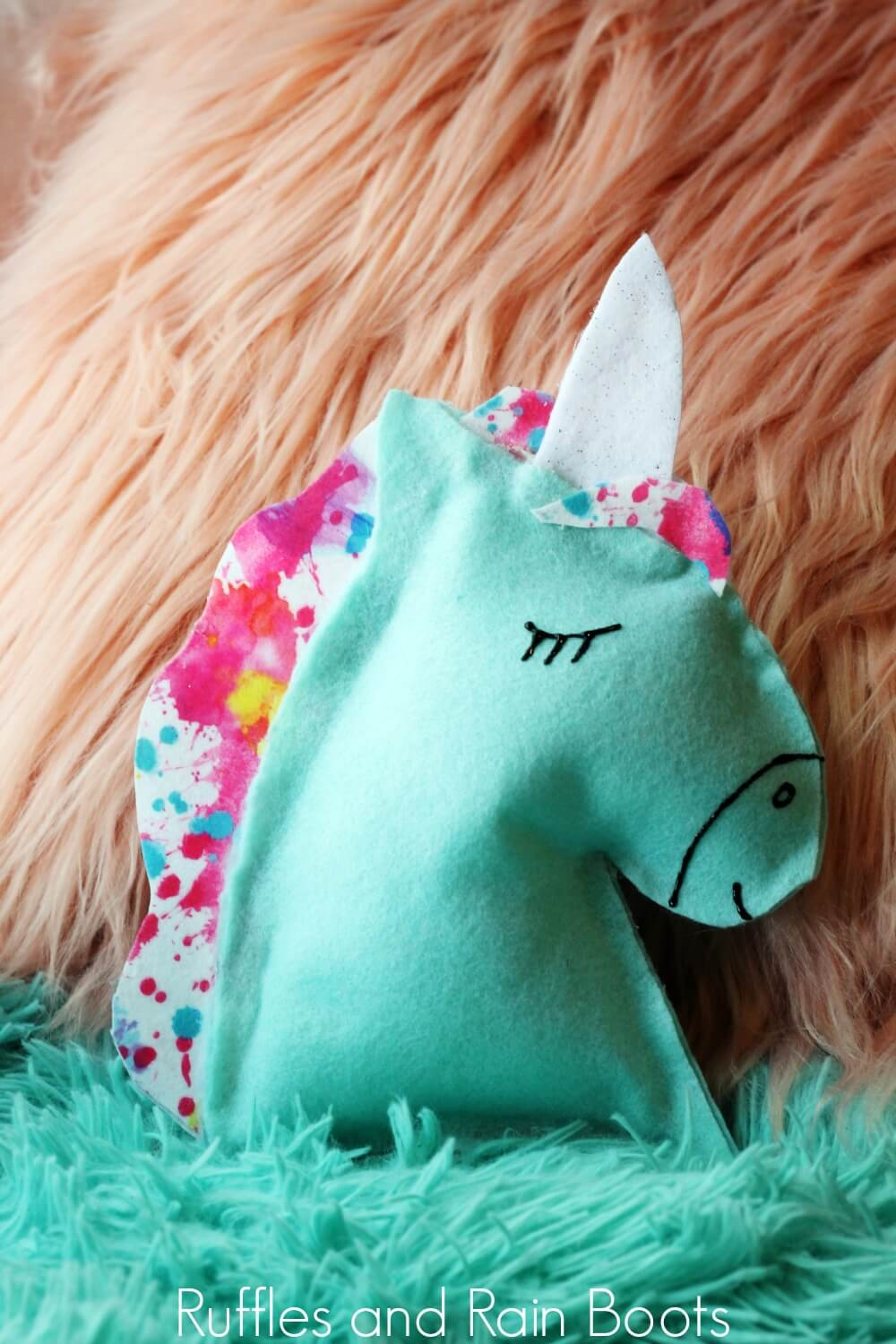 completed unicorn pillow on shaggy rug