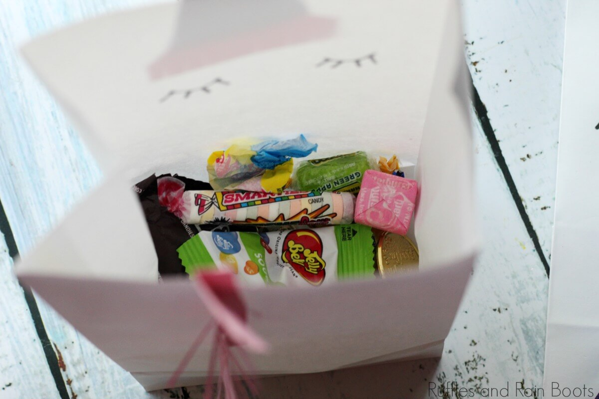 fill theunicorn favor bag with candy or toys