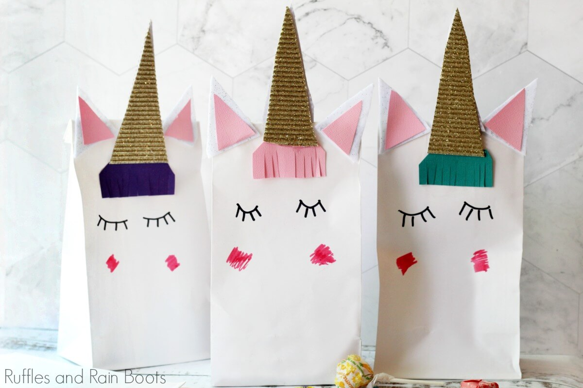 3 completed unicorn favor bags on white table top
