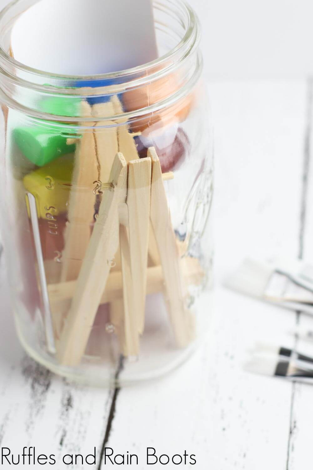 easy and fun date night idea for painting date night in-process step of miniature easels in the mason jar on a white background