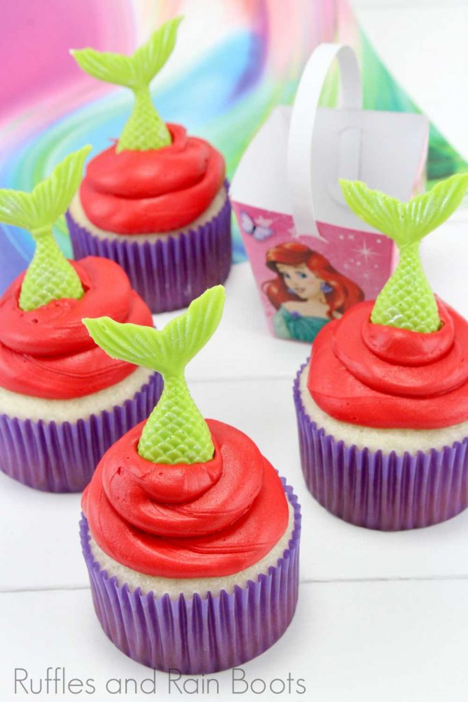 little mermaid cupcakes on a white background