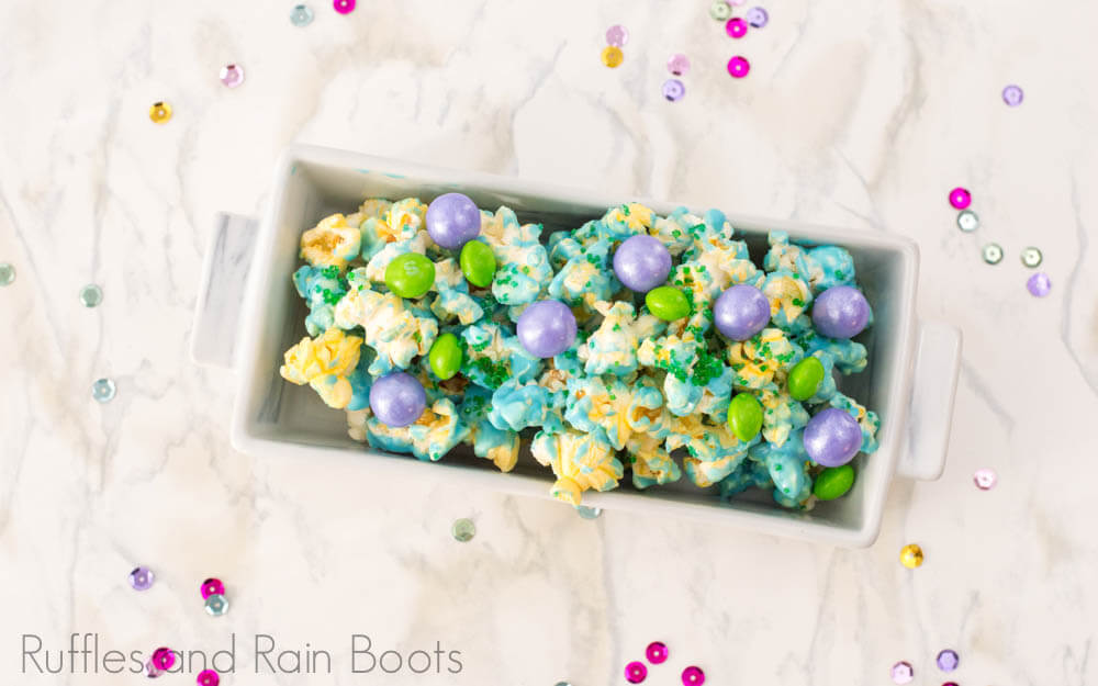 easy mermaid popcorn for party in a rectangle bowl on white background