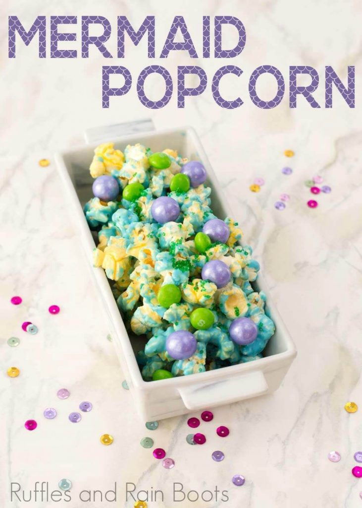 mermaid popcorn a fun mermaid party food idea in a rectangle bowl on a white background with text which reads mermaid popcorn