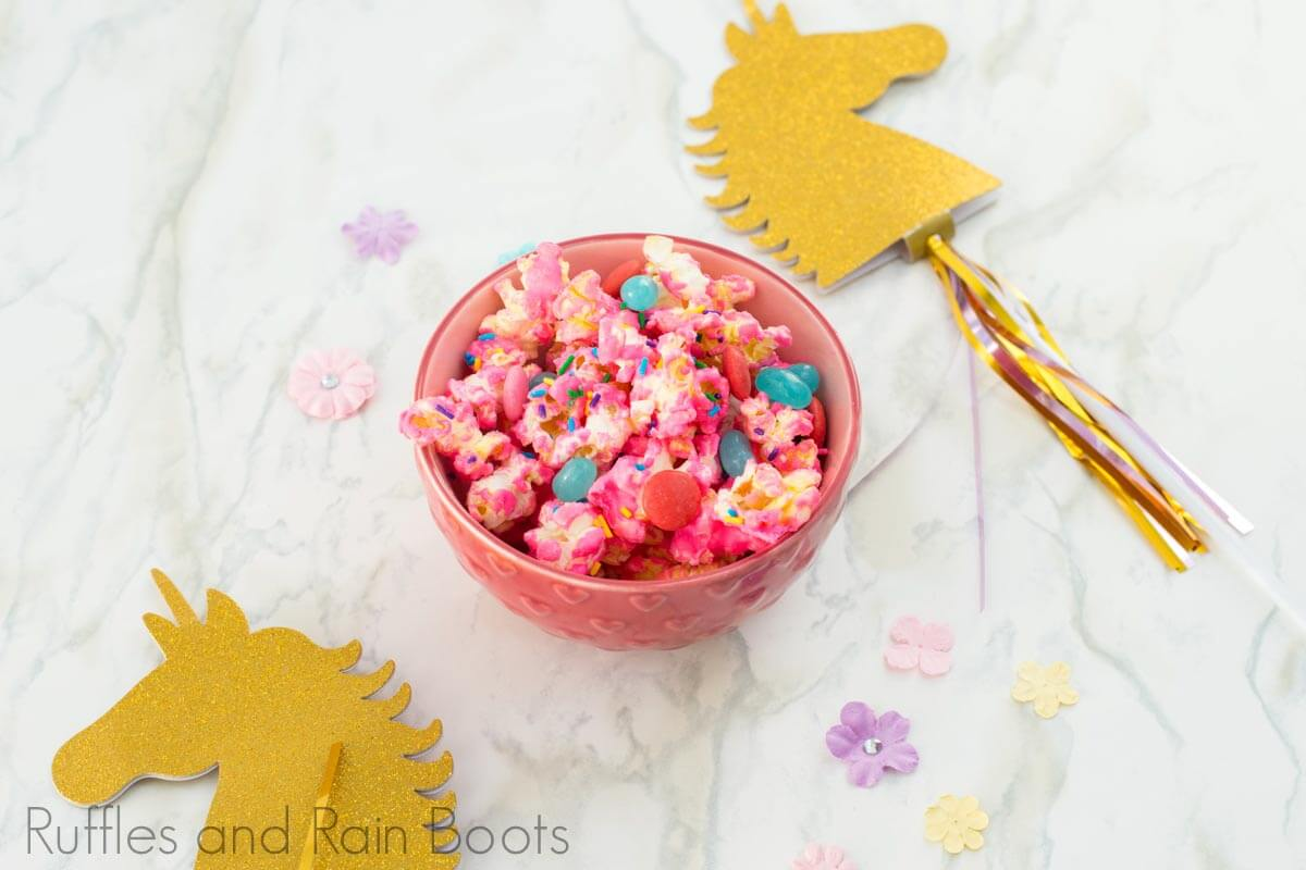 unicorn popcorn recipe in a pink bowl on a white background