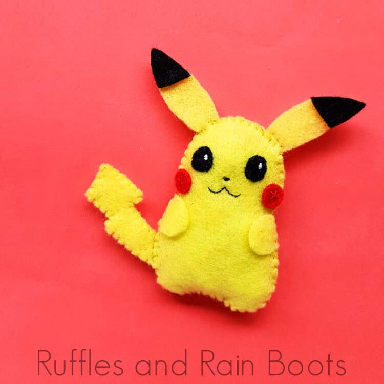 pikachu pattern and plush doll on a red background